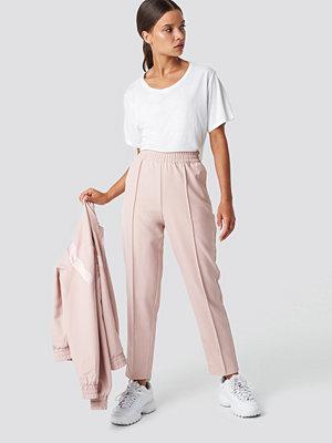NA-KD cremefärgade byxor Elastic Waist Seamline Pants rosa