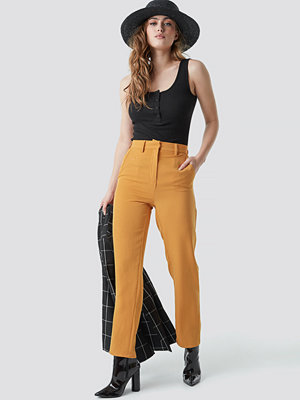 NA-KD Classic omönstrade byxor High Waist Suit Trousers orange