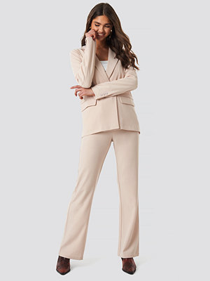NA-KD Classic omönstrade byxor Loose Fit High Waist Pants beige