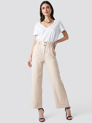 NA-KD Trend omönstrade byxor Fold Up Shirred Detail Pants beige