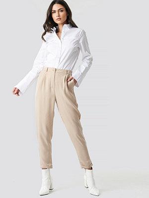 Trendyol omönstrade byxor Lyocell Carrot Pants beige