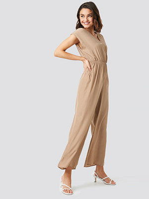 Jumpsuits & playsuits - NA-KD Overlap Solid Jumpsuit beige