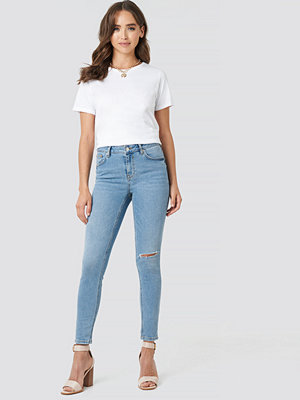 NA-KD Low Rise Distressed Skinny Jeans blå