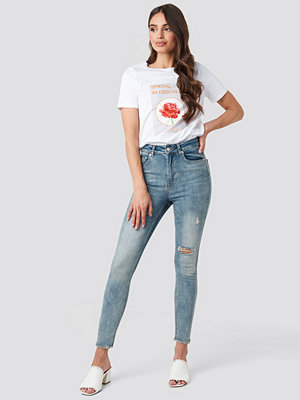 NA-KD Skinny High Waist Worn Look Jeans blå