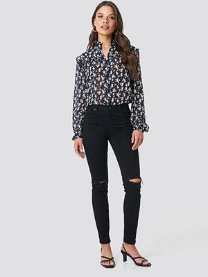 NA-KD Medelhöga Skinny Jeans Med Slitningar svart