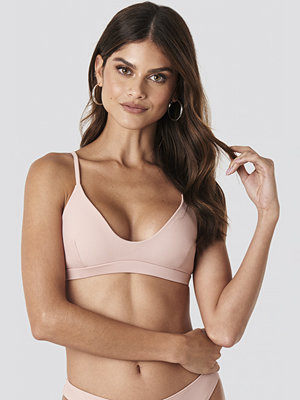 Gerda x NA-KD Deep Neck Sporty Bikini Top rosa