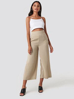 NA-KD omönstrade byxor Wide High Waist Pants beige