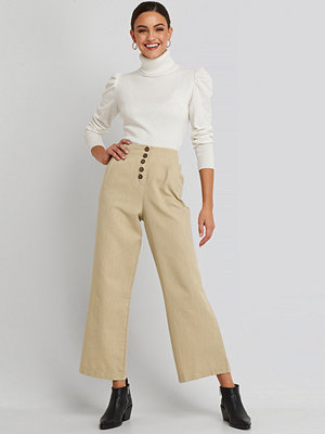 Trendyol omönstrade byxor Front Button Detailed Trousers beige