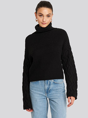NA-KD Trend Cable Sleeve High Neck Sweater svart