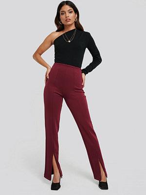 NA-KD vinröda byxor Front Slit Zipper Jersey Skinny Trousers burgundy