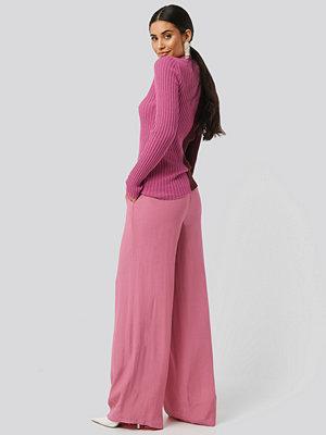 NA-KD omönstrade byxor Wide Flowy Pants rosa