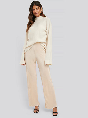 NA-KD Trend omönstrade byxor Mini Pleated Babylock Pants nude