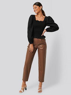 NA-KD Trend Byxor I Skinnimitation brun bruna