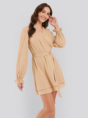 NA-KD Boho Overlap Draped Mini Dress beige
