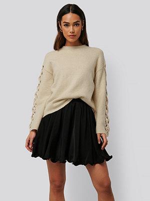 Kjolar - Anika Teller x NA-KD Plisserad Minikjol svart