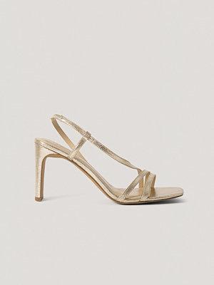 NA-KD Shoes Högklackade Sandaler guld