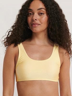 NA-KD Swimwear Bikiniöverdel gul