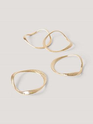 NA-KD Accessories smycke Hamrade Vågiga Armband guld