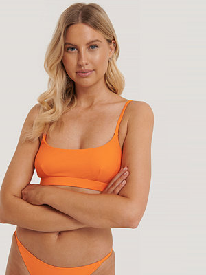 NA-KD Swimwear Bikiniöverdel orange