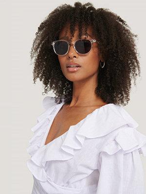 Corlin Eyewear Transparenta Solglasögon vit