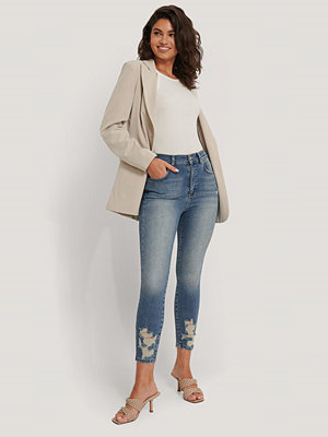 NA-KD Reborn Skinny Jeans I Ekologisk Bomull Med Sliten Fåll blå