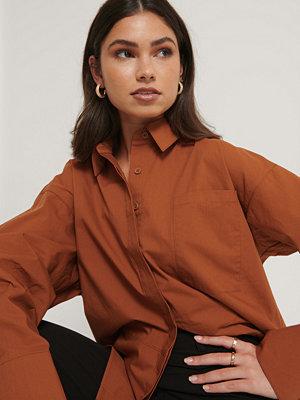Manon Tilstra x NA-KD Ekologisk Oversize Skjorta Med Bröstficka orange