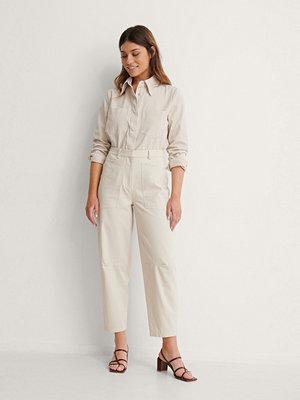 NA-KD Reborn omönstrade byxor Soft Cotton Cargo Pants beige