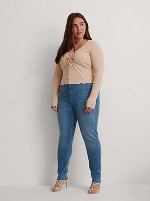 NA-KD Ekologiska Skinny Jeans Med Hög Midja Och Rå Fåll blå