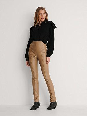 Leggings & tights - NA-KD Pu-Leggings beige