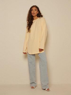 NA-KD Ekologisk Oversize T-shirt Med Sidoslits gul