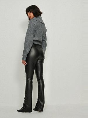 Leggings & tights - NA-KD Trend Pu-Leggings Med Sidoslits svart