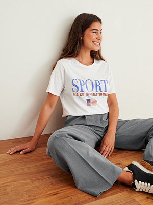 NA-KD Trend Ekologisk sport t-shirt med tryck vit