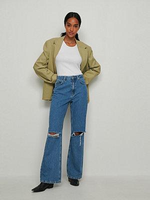 NA-KD Trend Ekologiska destroyed jeans med lös passform blå