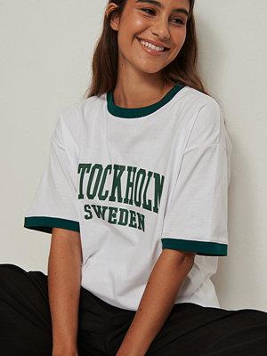 NA-KD Trend Ekologisk oversize t-shirt med city tryck vit
