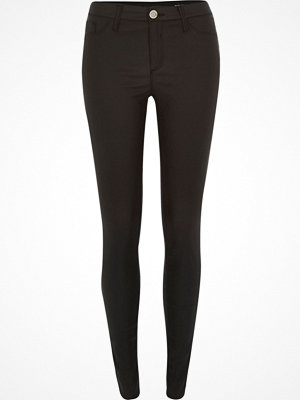 Jeans - River Island Black coated Molly jeggings