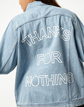 River Island Plus light blue slogan print denim jacket
