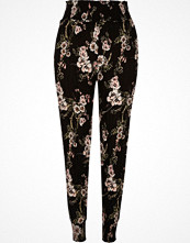 River Island Black floral print tapered trousers