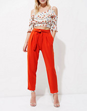 River Island Petite red tie waist tapered trousers