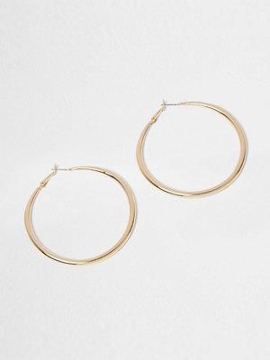 River Island örhängen Gold tone hoop earrings