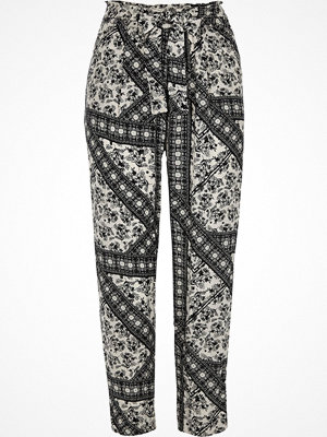 River Island Black floral print tie waist tapered trousers