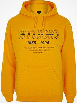 Street & luvtröjor - River Island Yellow 'studio' print hoodie