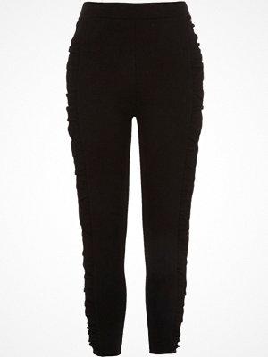 Leggings & tights - River Island Black frill side ponte leggings