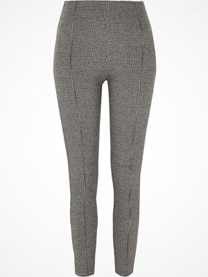 Leggings & tights - River Island Black dogtooth print leggings