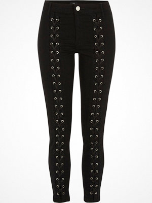 Jeans - River Island Black lace-up front skinny Molly jeans