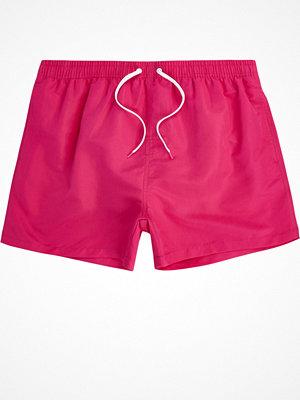 Badkläder - River Island Bright Pink swim shorts