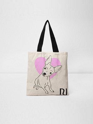 River Island väska med tryck Beige heart and dog print shopper bag