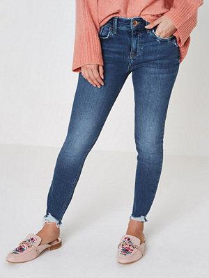 River Island Petite Blue Amelie rip hem super skinny jeans