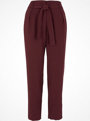 River Island omönstrade byxor River Island Womens Burgundy tie waist tapered trousers