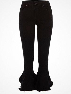 River Island Black Amelie frill flare hem skinny jeans