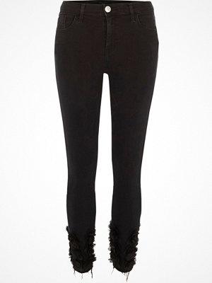 River Island Black 3d flower hem Amelie super skinny jeans